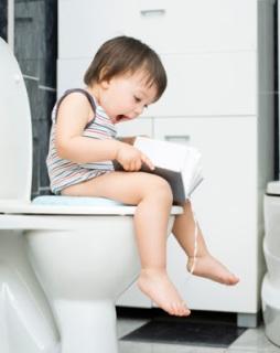 Little boy on toilet